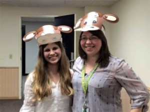 Courtney Johnson (R) shows her love for cows as she engages with young people to build stronger community for all.